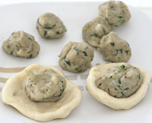 Potato Balls with a few added into the balls of dough